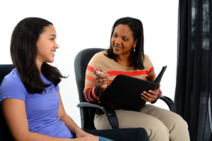 caregiver giving advice to a young girl