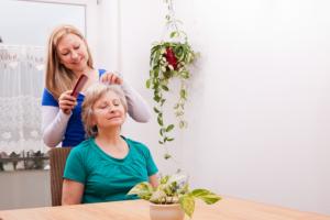 caregiver combing her patient hair